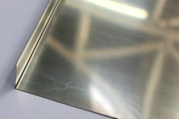Imagem de chapa de aço inox, utilizado nos serviços de caldeiraria, oxicorte e corte a laser.